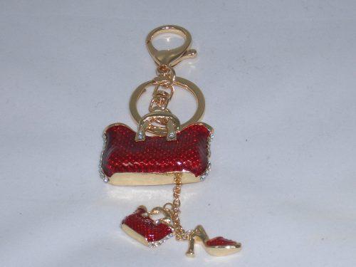 Taschenanhänger mit roten Handtaschen und Highheels