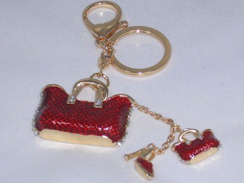 Taschenanhänger oder Schlüsselanhänger mit Strass und roten Applikationen
